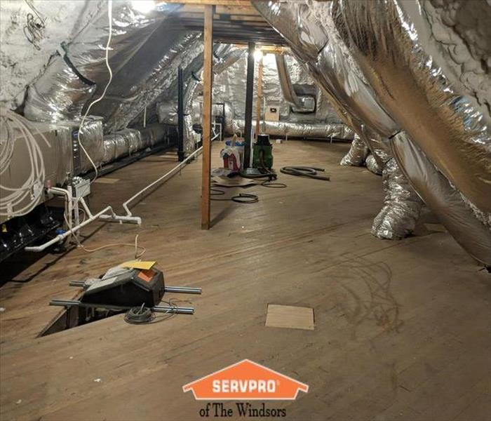 Attic-wood floors, ducting, mechanicals, insulation, heavy dust, SERVPRO logo
