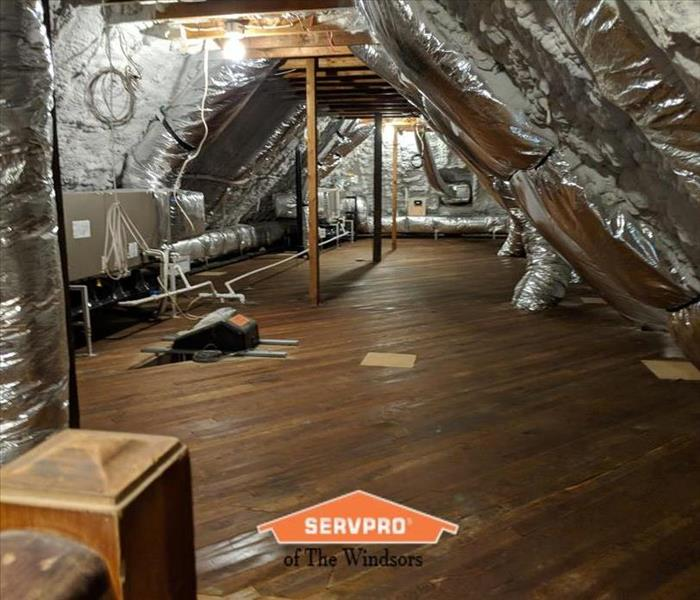 Attic-wood floors, ducting, mechanicals, insulation, SERVPRO logo
