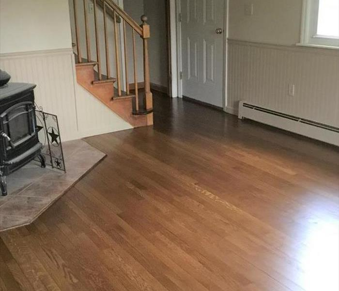 room with new shiny floors, fireplace, staircase, glare