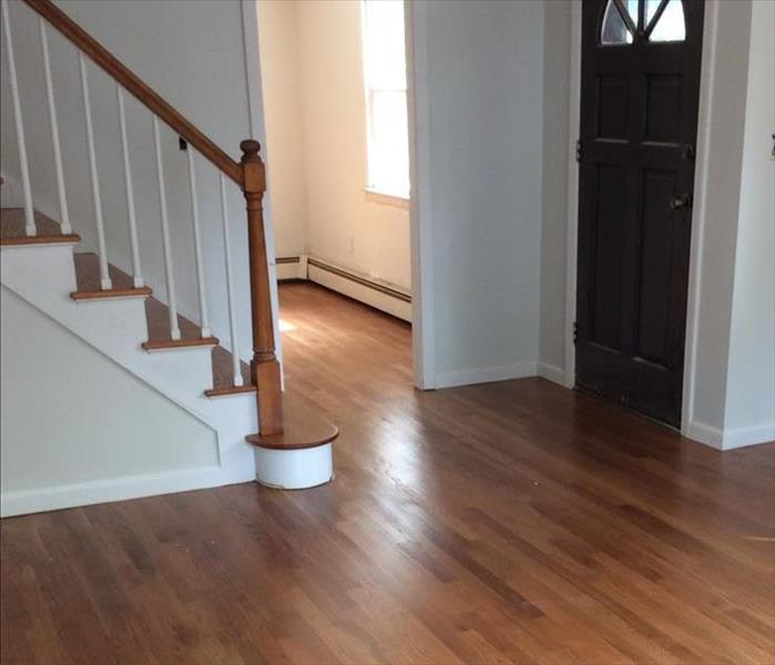 Residential property, wood floors, front door and staircase