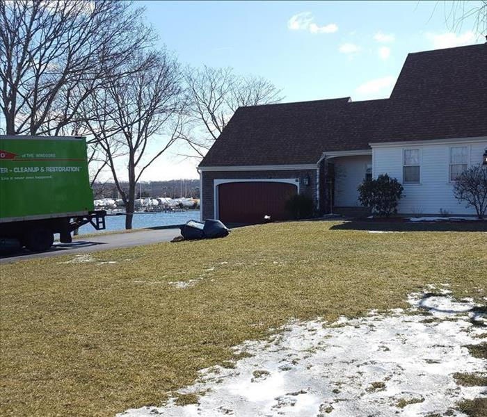 SERVPRO windsors in stonington, SERVPRO box truck in drivewa of water front property, house, driveway, front lawn