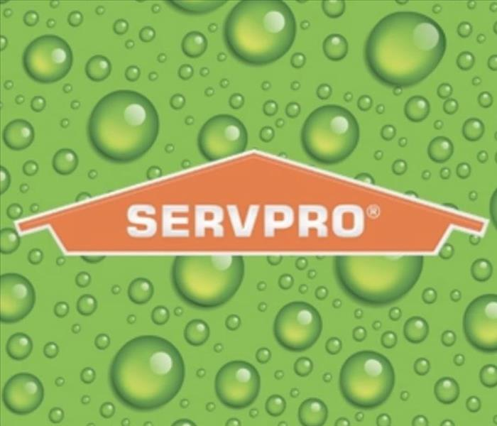 servpro logo with green back drops with water droplets