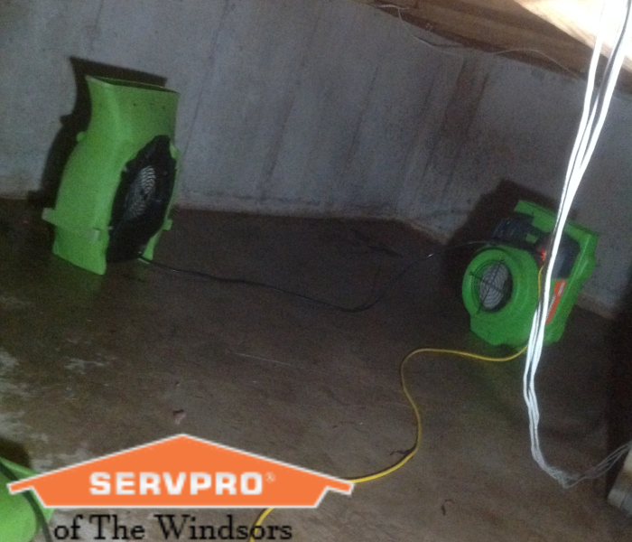 crawlspace, four foot high, tight space with green air movers in place, servpro logo.