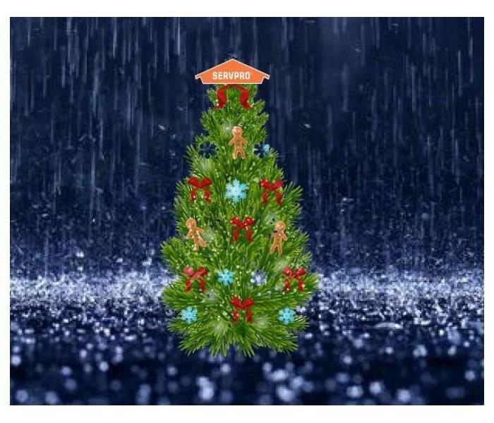 Christmas tree with servpro logo tree topper in the rain, ornaments, bows gingerbread man