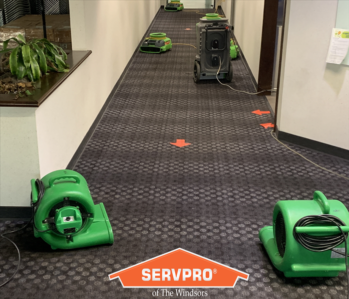 commercial hallway with carpet and wall, drying equipnet in place, servpro logo, windosr ct