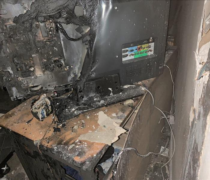 television burned, melting tv, house fire in windsor locks, servpor of the windsor, charred wall`